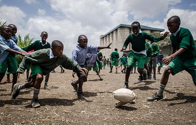 Children play football at a low-cost informal school in Nairobi. Research by APHRC has helped the Government of Kenya develop policies on school access. © African Population and Health Research Centre