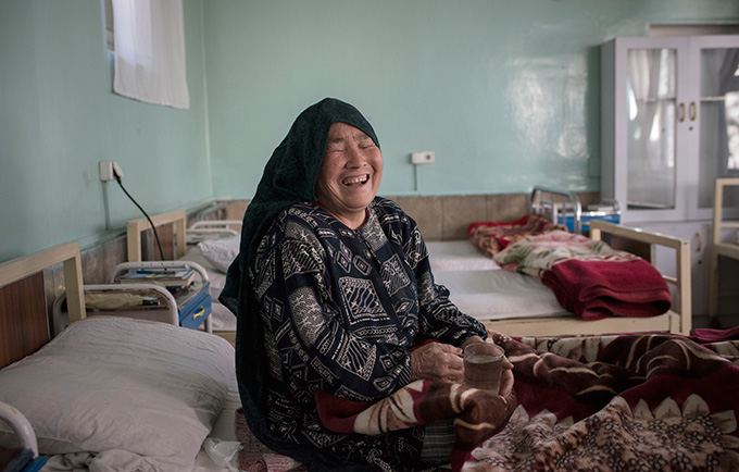 """Noorjahan laughs as she recovers from fistula surgery in Malalai Hospital in Kabul, Afghanistan. Now, she says, """"I can live."""" © Andrea Bruce/ NOOR"""