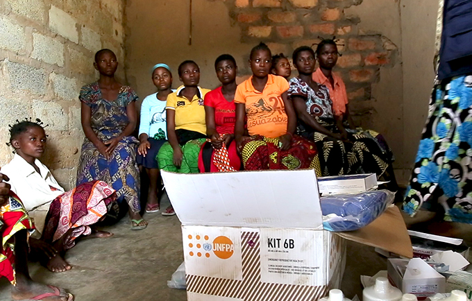Pregnant women wait to be screened at the Kalomba health center during a UNFPA-supported mobile clinic. © UNFPA DRC
