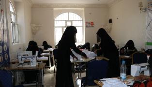 Women make face masks in a safe space in Yemen.