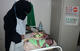 A midwife cares for Mohsina's unexpected twins at Jardan Hospital. ©FMF