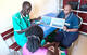 For midwife Peter Door, spreading awareness about family planning is key to strengthening women's well-being and economic stability. Peter provides information on family planning to a mother in a Rumbek clinic. © UNFPA South Sudan