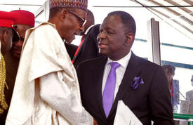 UNFPA Executive Director Dr. Babatunde Osotimehin shakes hands with His Excellency Muhammadu Buhari President of Nigeria.