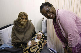 Dr. Natalia Kanem with Syrian mother at the Zaatari Maternity Clinic in Jordan. © UNFPA Jordan/Elspeth Dehnert