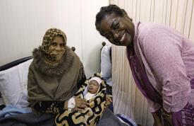 Dr. Natalia Kanem with Syrian mother at the Zaatari Maternity Clinic in Jordan. © UNFPA Jordan/Elspeth Dehnert